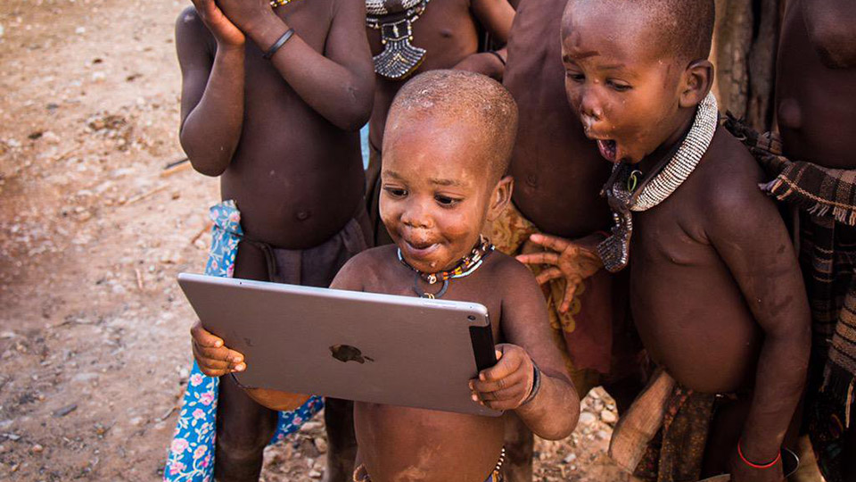 African children looking at iPad