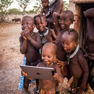 Photographer: African children looking at iPad